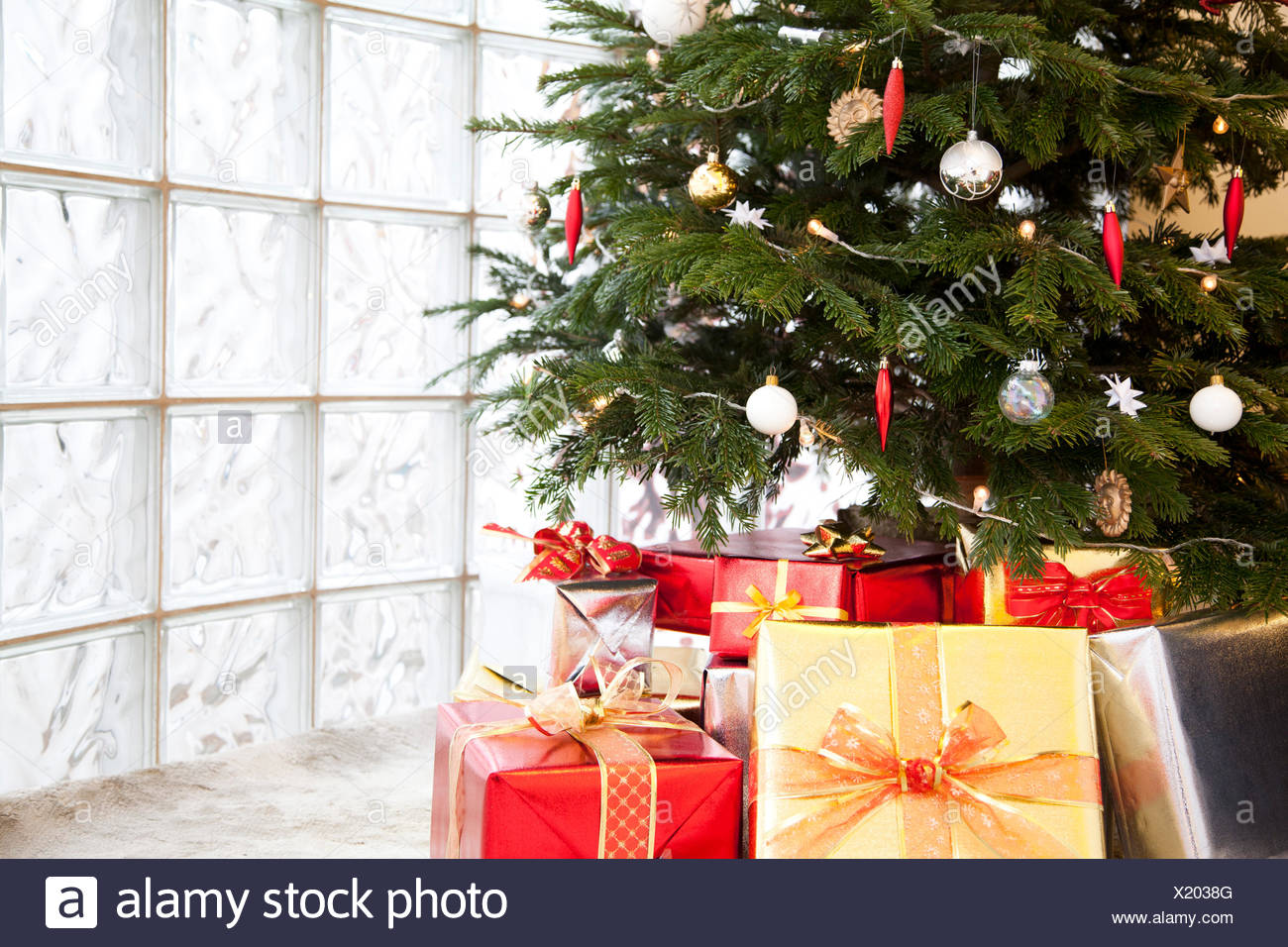 Close up of gifts under a Christmas tree - Stock Image