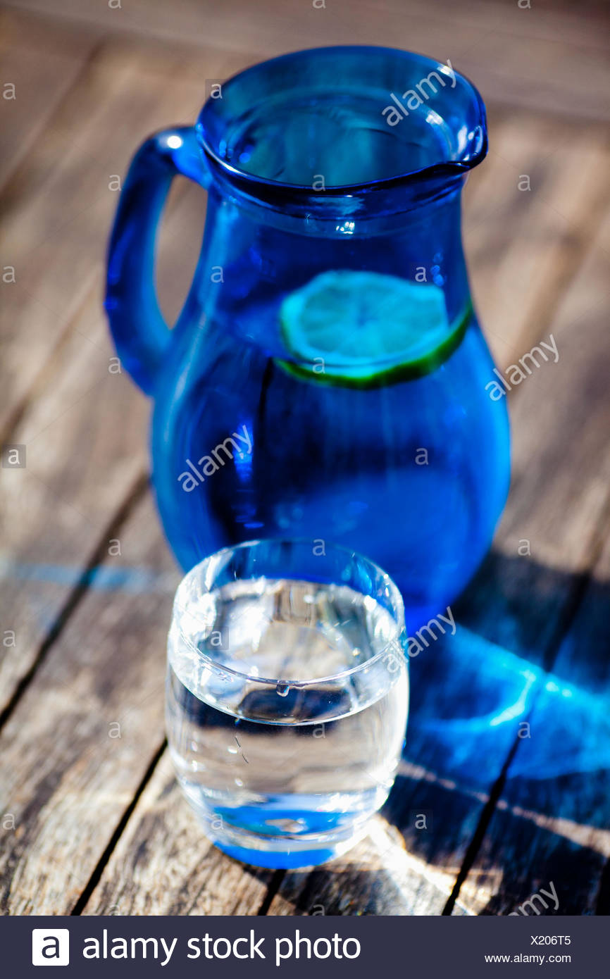 Carafe and glass of water. - Stock Image