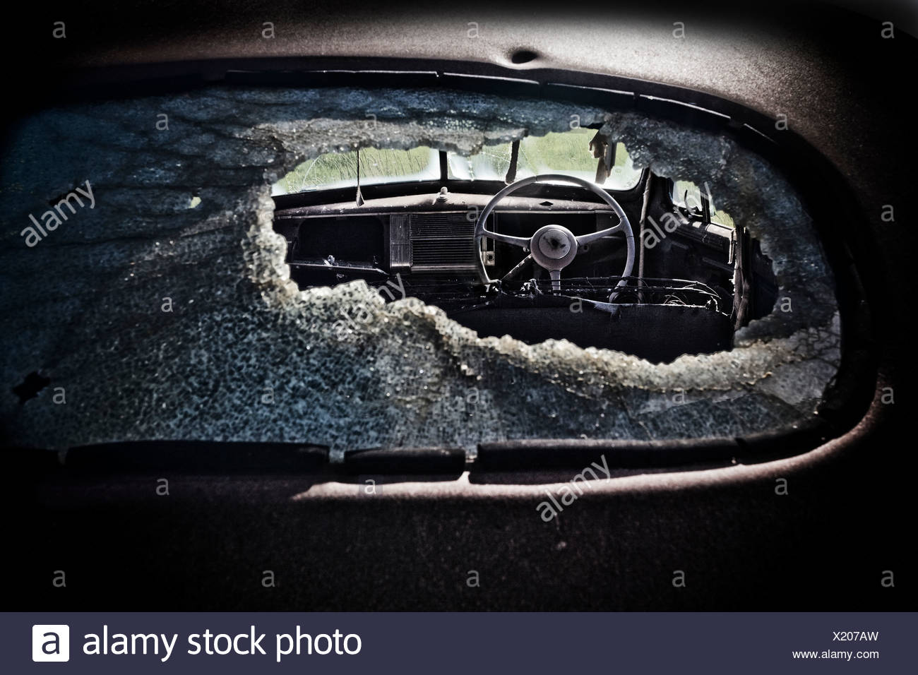 View though old Chevy's smashed rear window, Saskatchewan, Canada Stock Photo