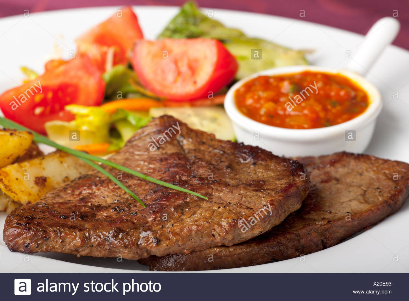steak with ketchup and potatoes - Stock Image