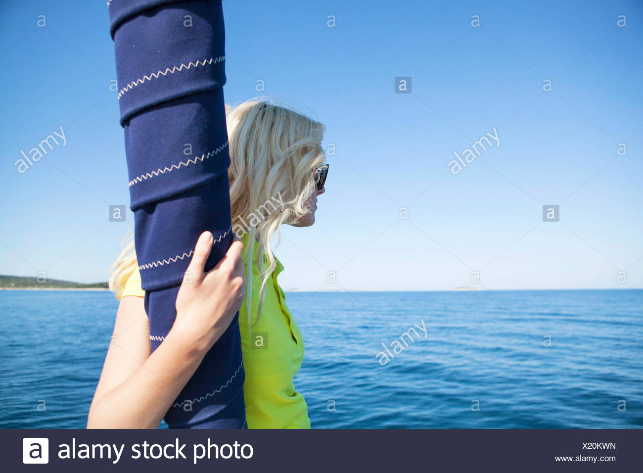 Woman overlooking seascape. Adriatic Sea - Stock Image