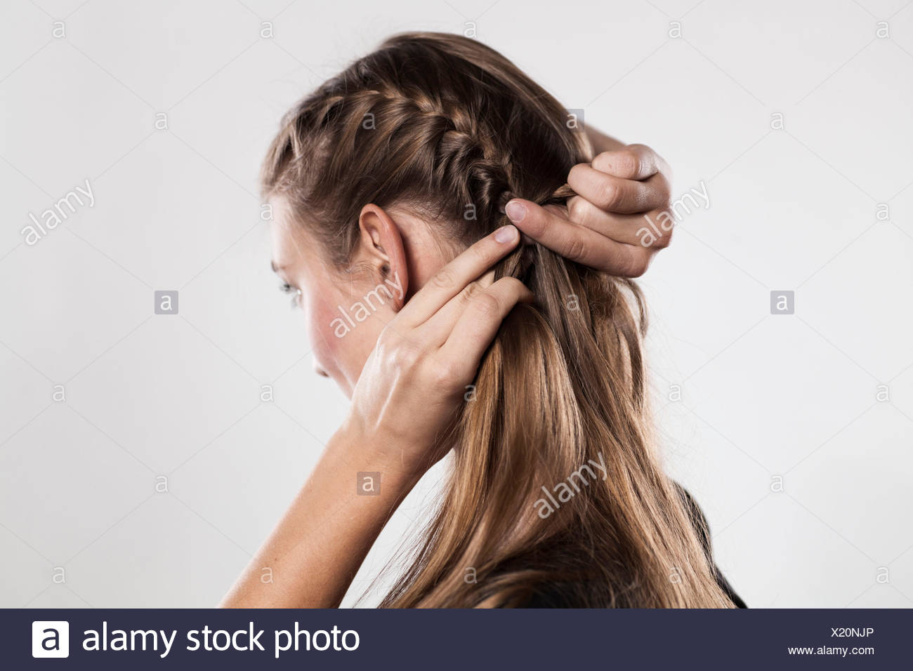 """Instruction: braided plaits, two """"Gretchen"""" braids, Step 1 from 3 Stock Photo"""