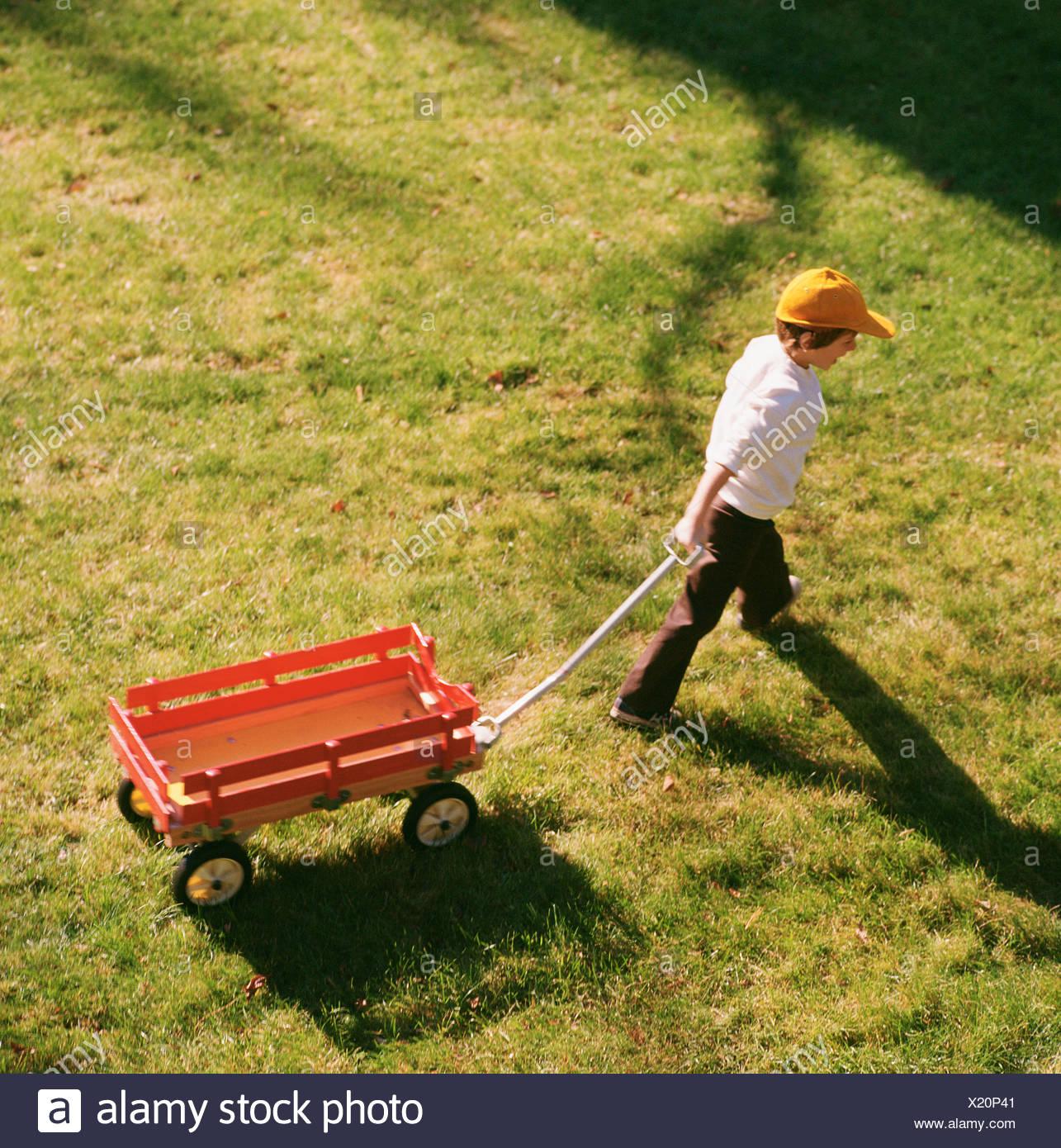 Pulling A Wagon : Boy pulling wagon stock photos