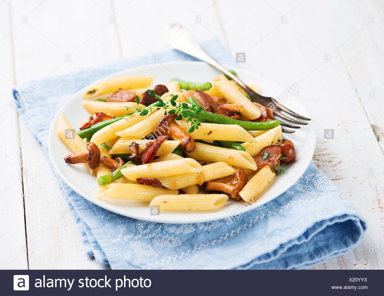 Pasta with chanterelles mushrooms - Stock Image