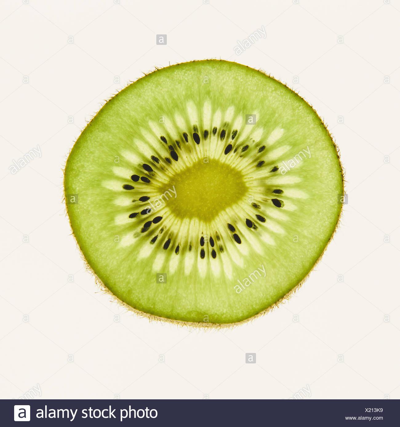 Organic kiwi slice, white background - Stock Image