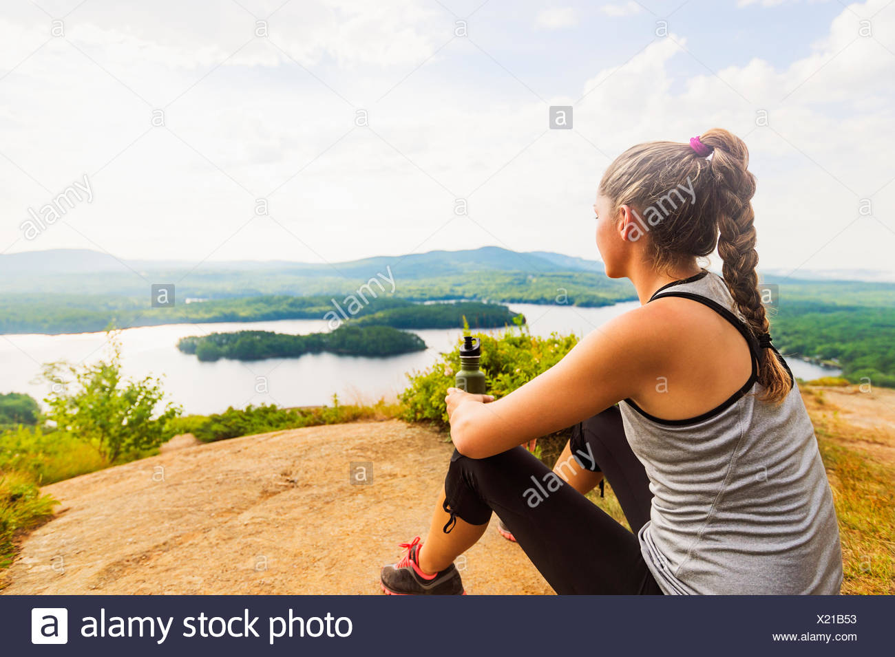Young female hiker looking at view - Stock Image