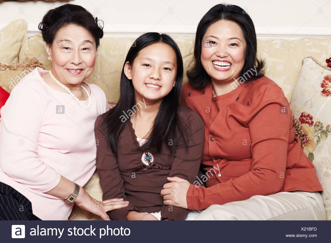 Portrait of a girl with her mother and her grandmother Stock Photo