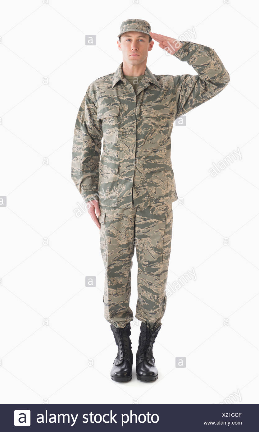 Studio shot of saluting soldier - Stock Image