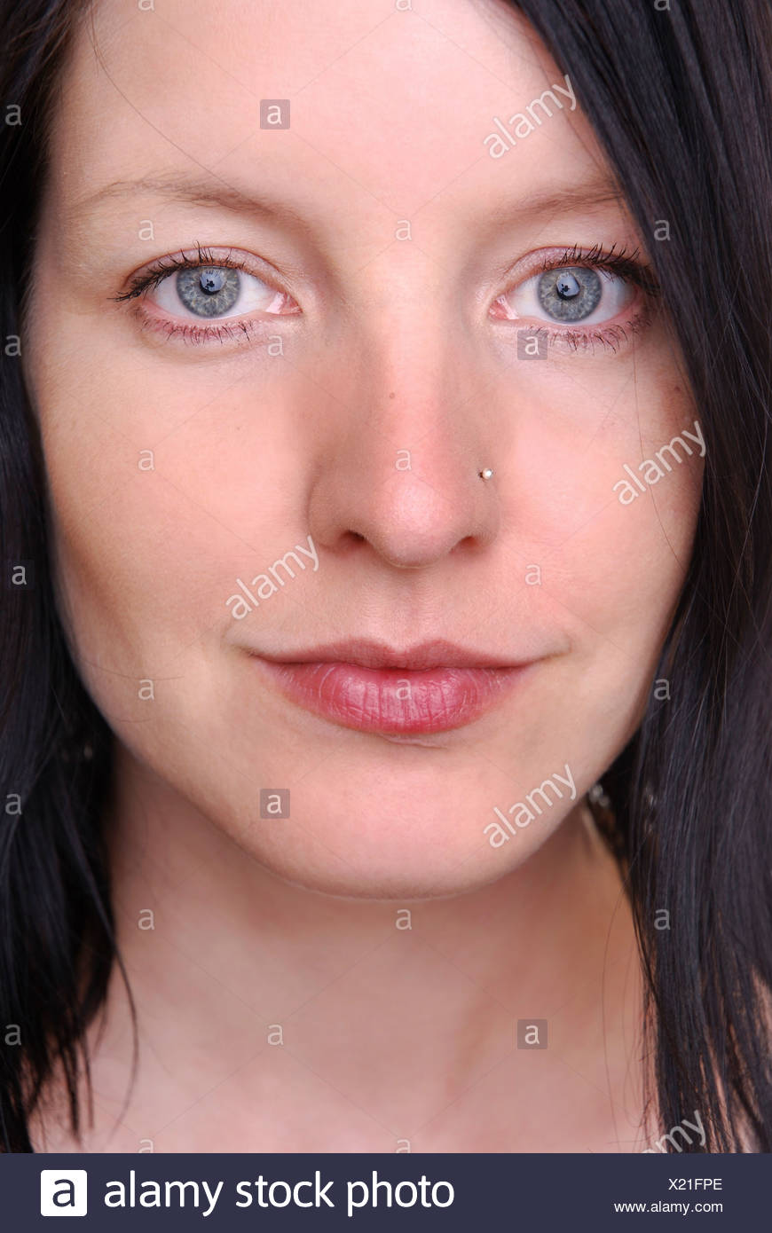 Woman looks thoughtfull - Stock Image