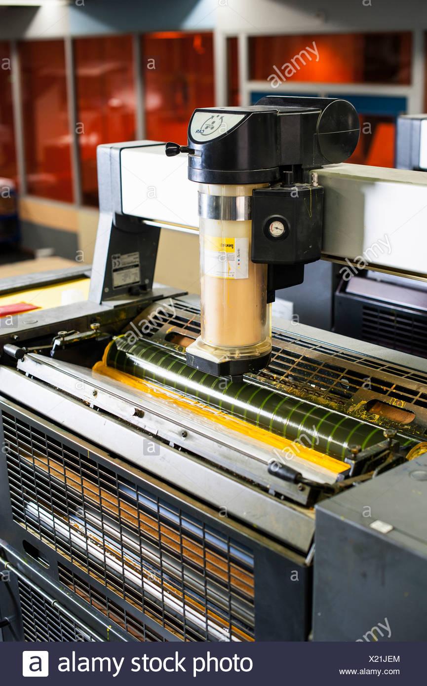 Printing machine in print workshop - Stock Image