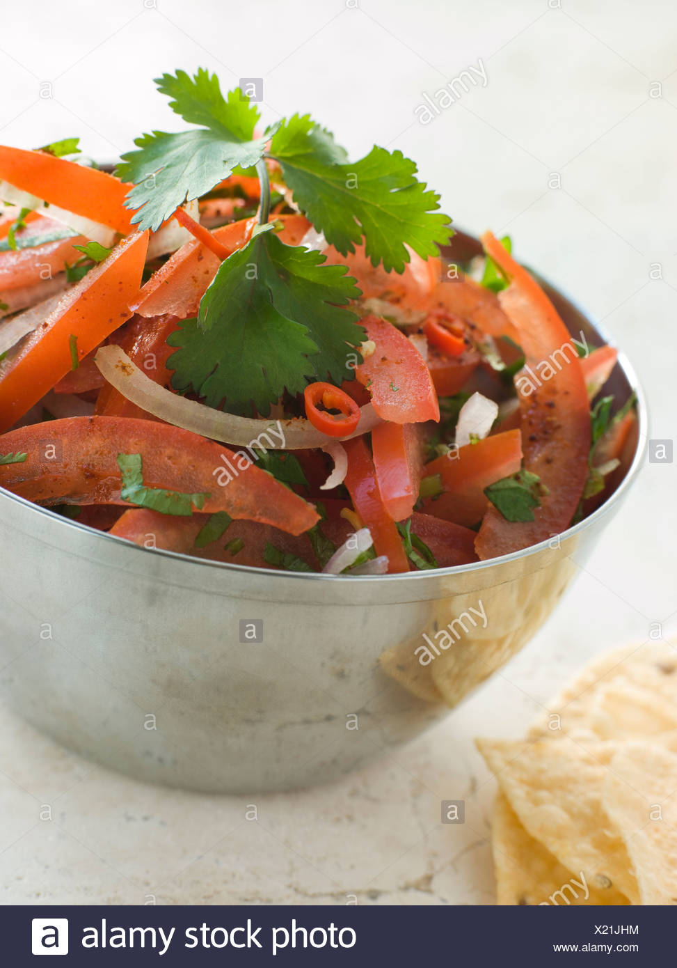 Dish of Tomato Red Onion and Coriander Relish - Stock Image