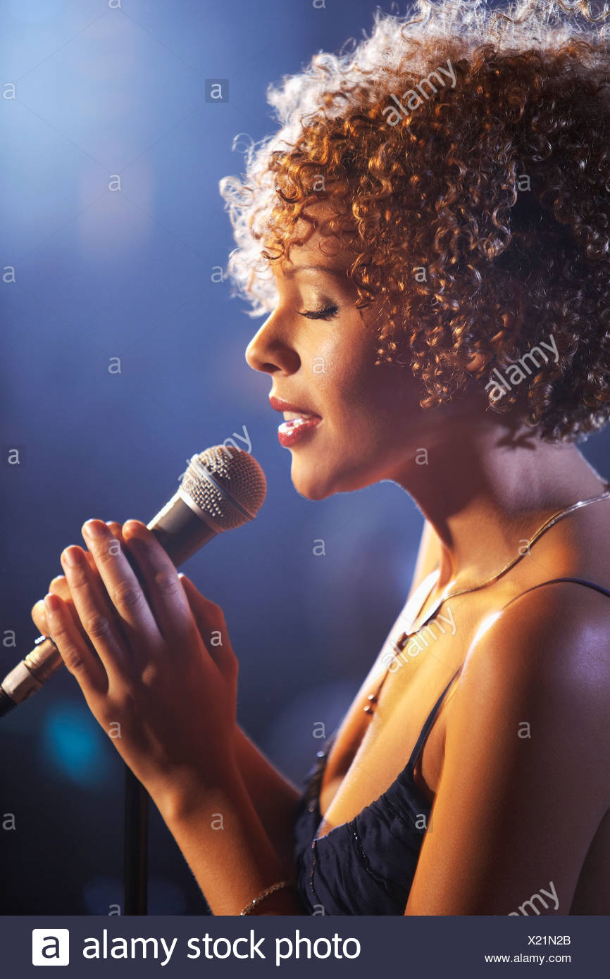 Jazz singer on stage, profile - Stock Image
