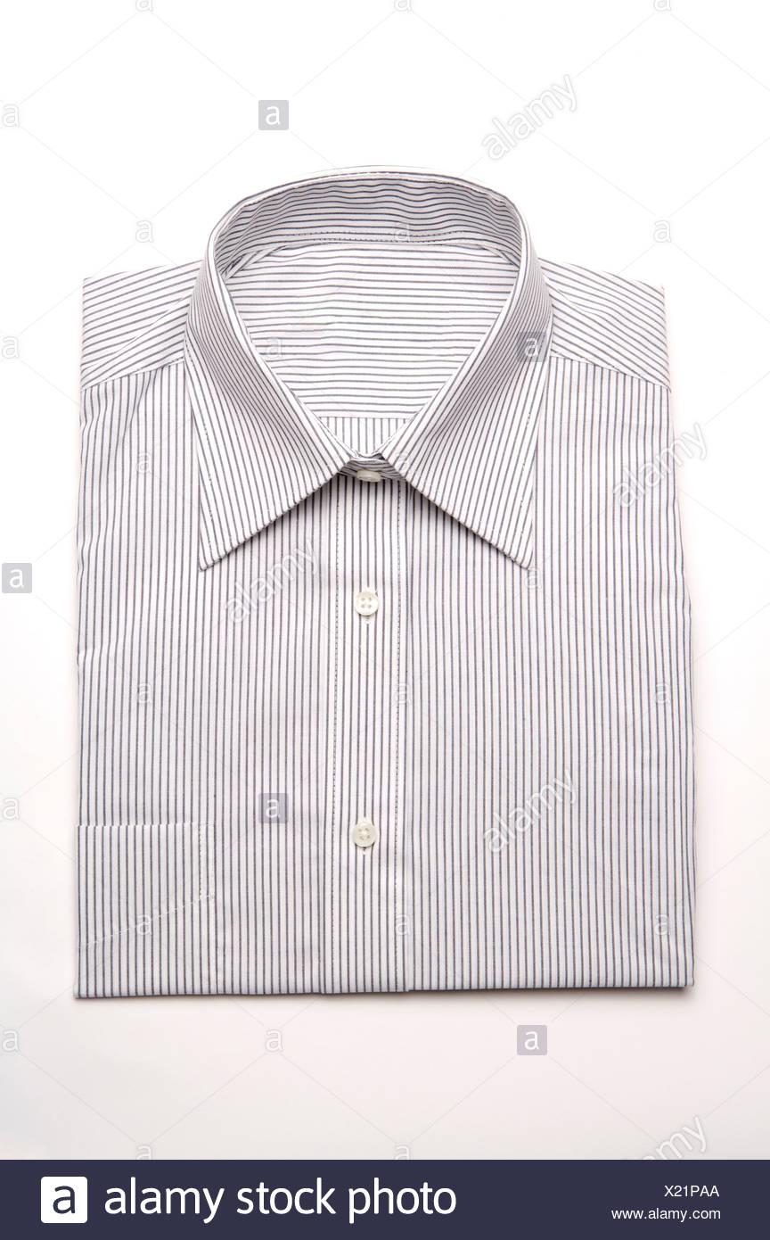 Neatly folded shirt - Stock Image
