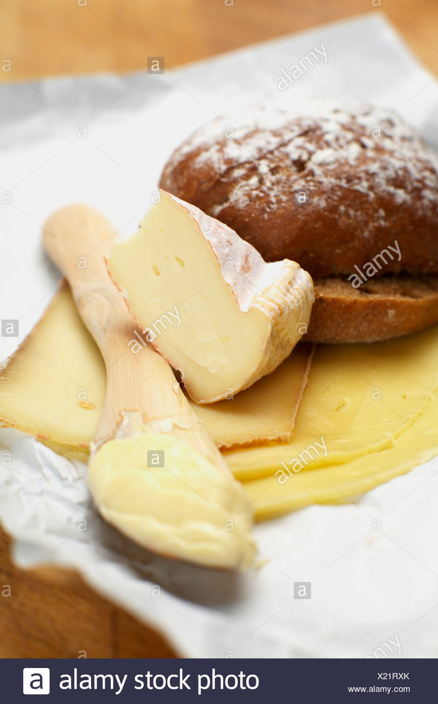 Varieties of cheese and bread roll - Stock Image