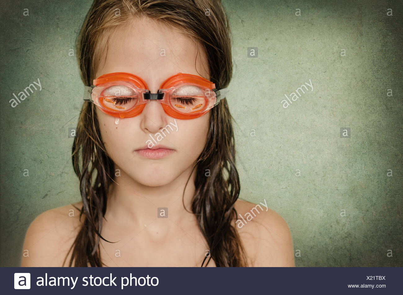 Portrait of a girl with her eyes closed wearing swimming goggles Stock Photo