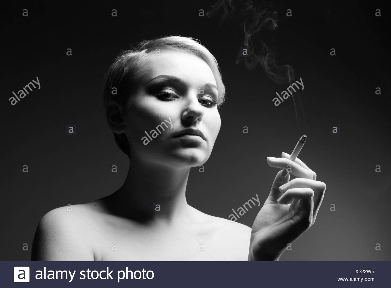 Black and white portrait of a woman with cigarette Stock Photo