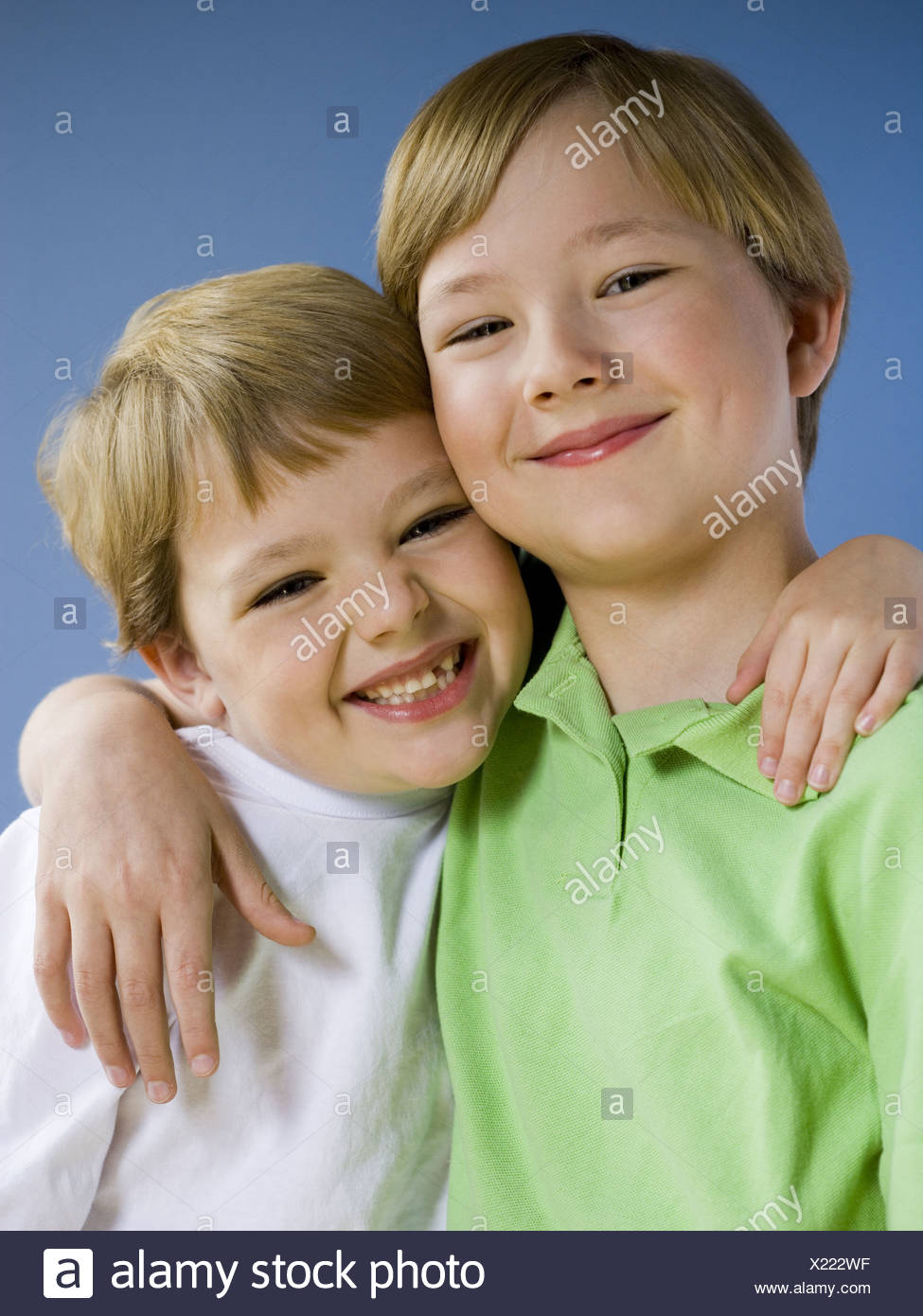 Portrait of two boys smiling - Stock Image