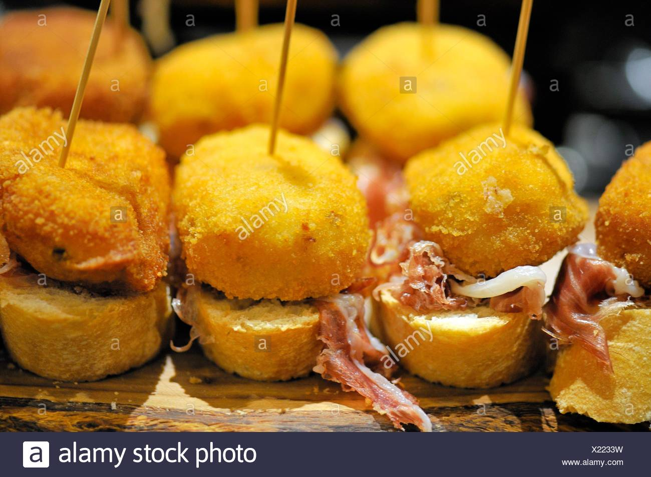Pintxos, also called tapas very typical at Basque country, Bilbao bar, North of Spain. - Stock Image