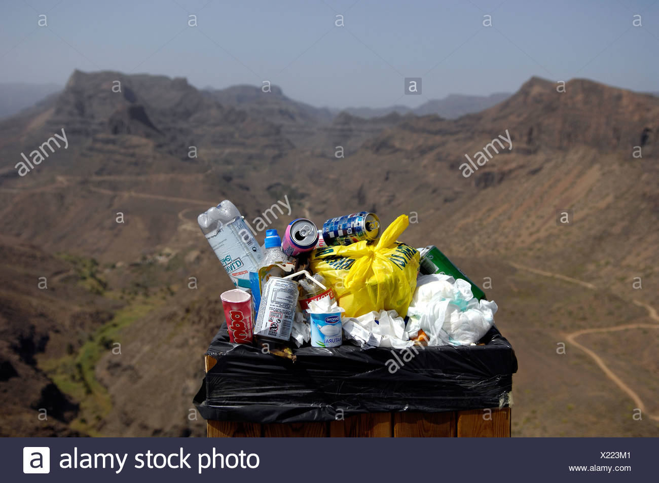 Crammed trash can in nature reserve, Gran Canaria, Canaries, Spain Stock Photo