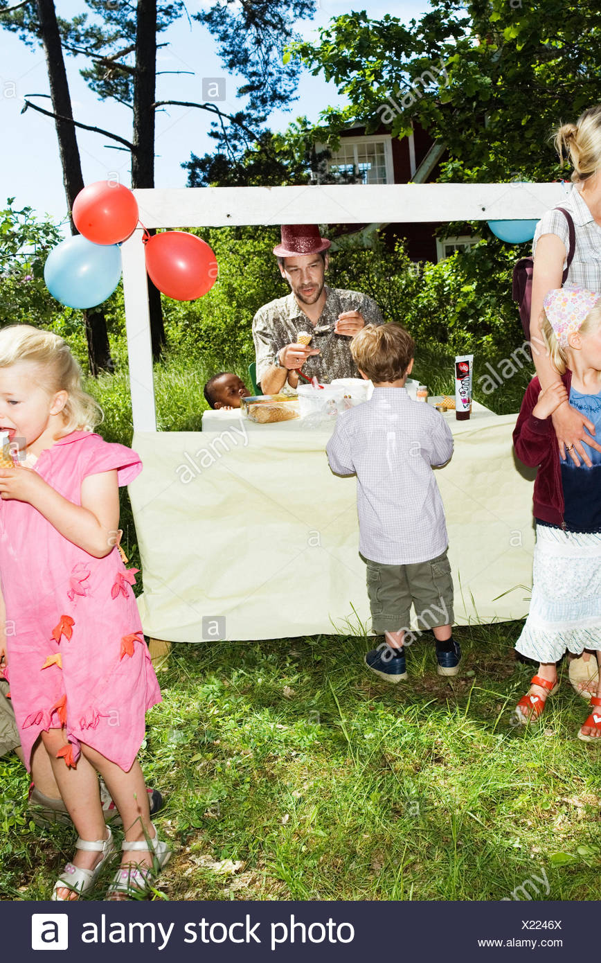 Children`s party with ice-cream outdoors. - Stock Image