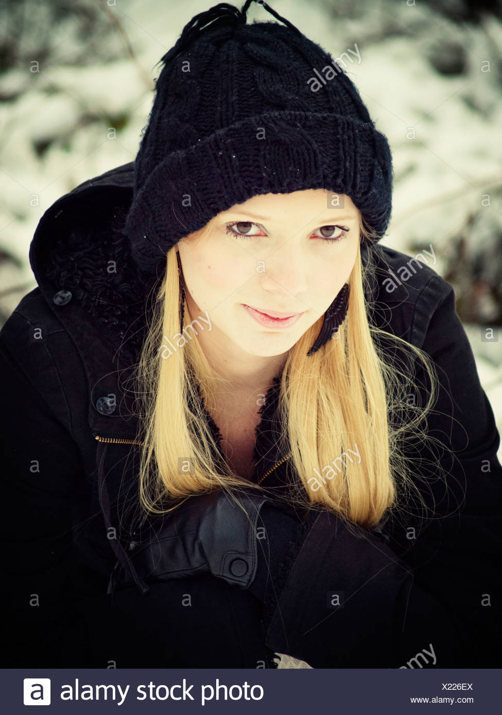 Blond woman in winter - Stock Image