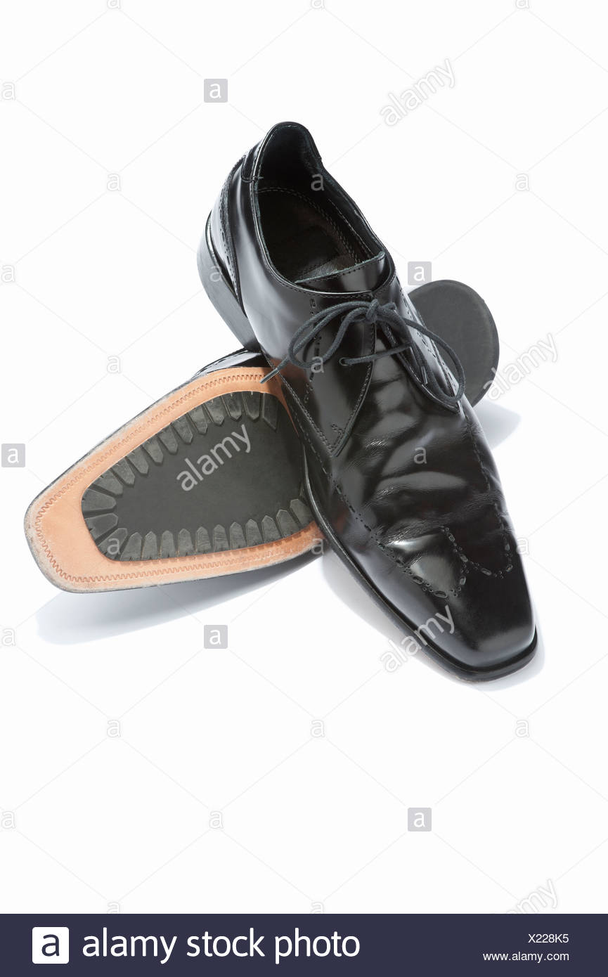 A pair of mens lace up black shoes Stock Photo: 276645913