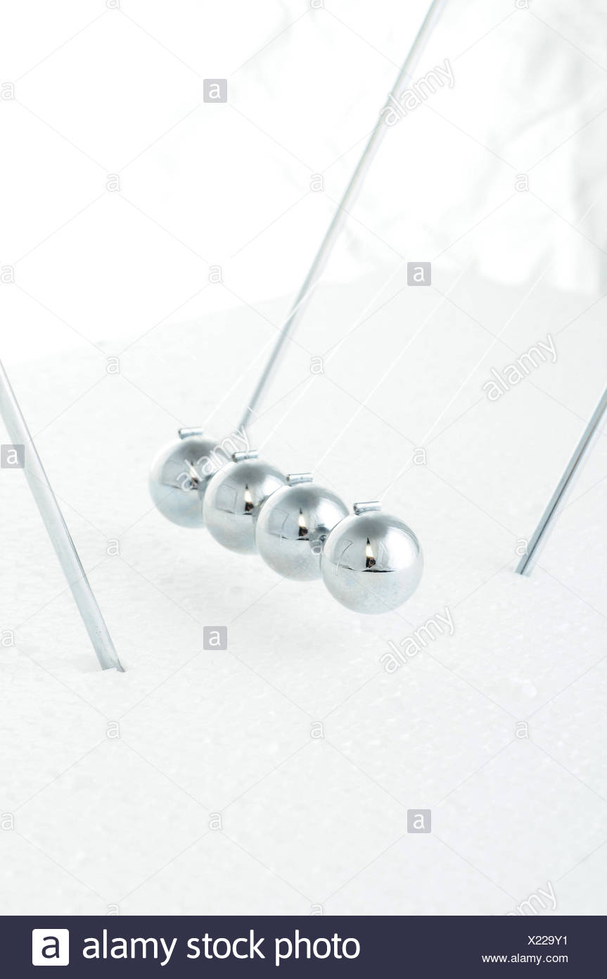 Sphere game, causal catena, reaction, game, oscillate, kick off chain reaction, kickoff, energy, sphere, silver, - Stock Image