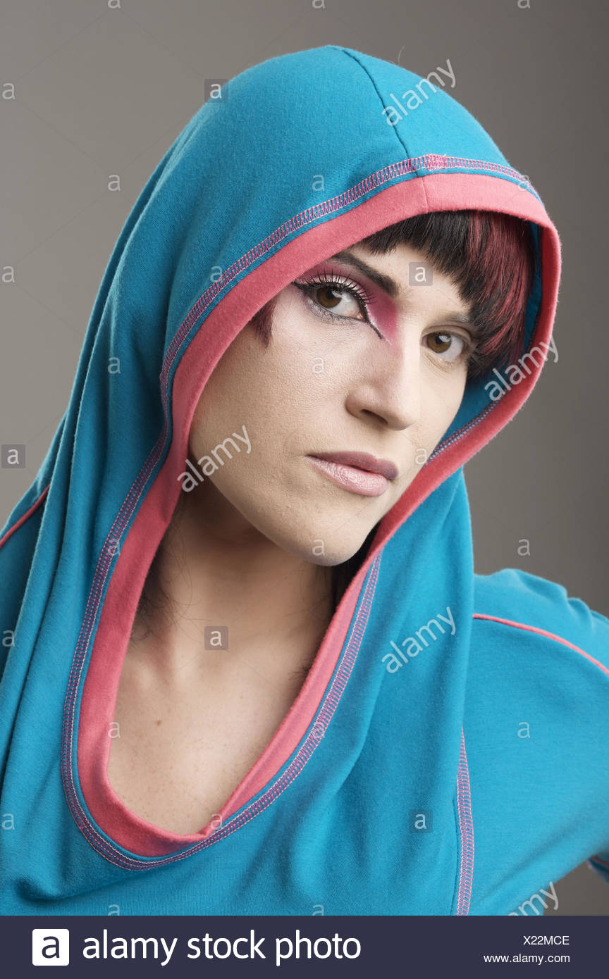 Redhaired Trendy Girl Wearing A Hood With Makeup On One Eye Stock