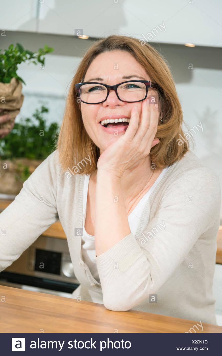 Senior woman laughing, portrait - Stock Image