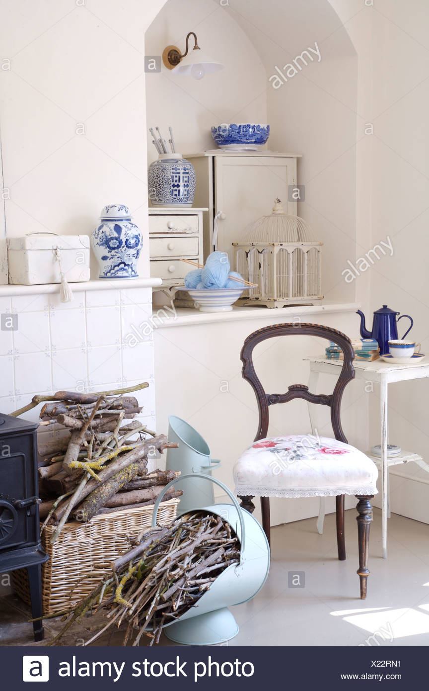 Victorian Chair With White Seat In Front Of Alcove In White Dining Room  With Kindling Wood In Baskets And Painted Coal Scuttle