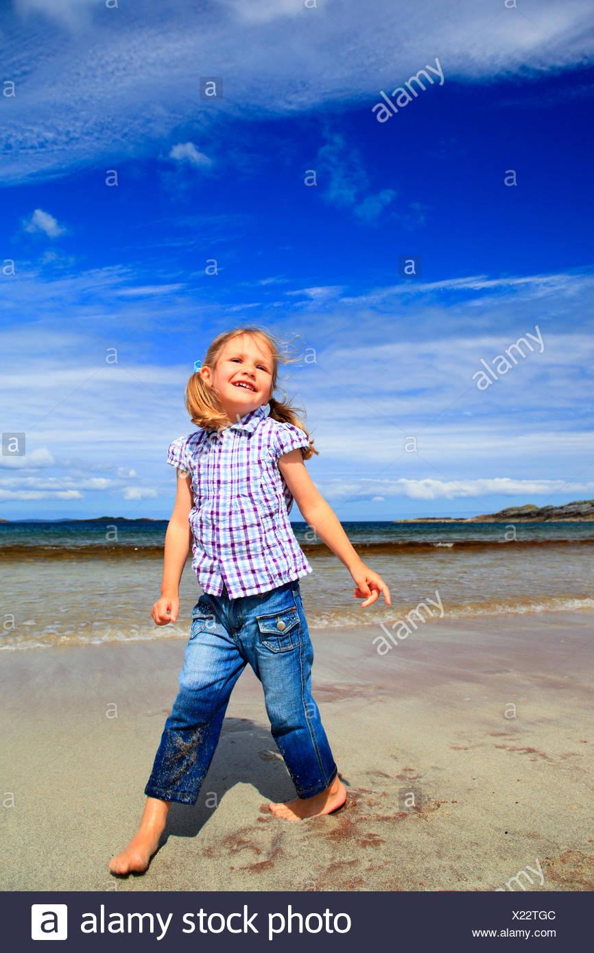 little girl on sandy beach, United Kingdom, Scotland, Sutherland - Stock Image