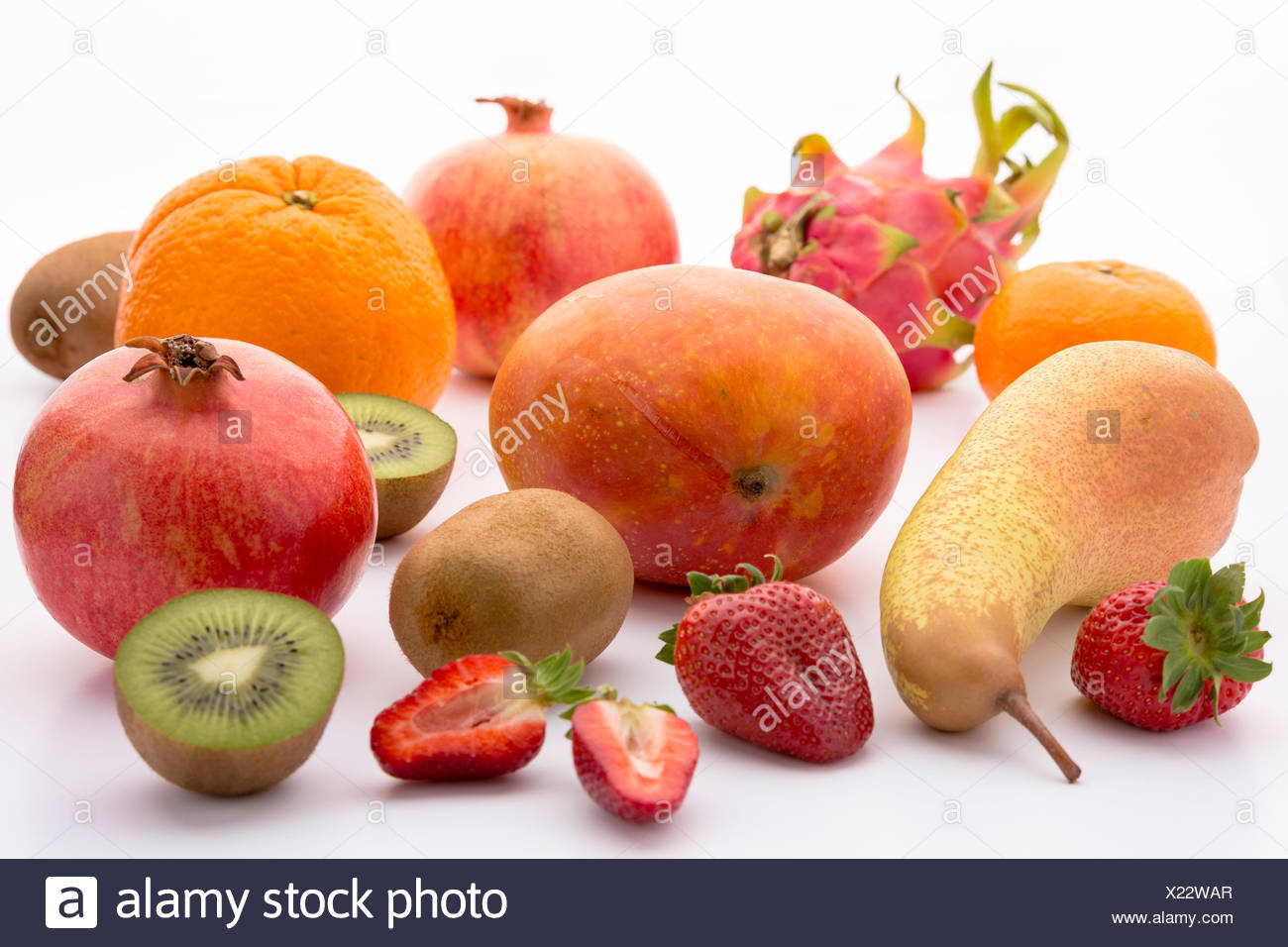 Exotic and mediterranean fruits for a multivitamin boost. Pitaya, mango, orange, mandarine, kiwi, pomegranate, pear and strawberry. Ranging in colour from green to orange, tangerine, red, purple and violet. - Stock Image