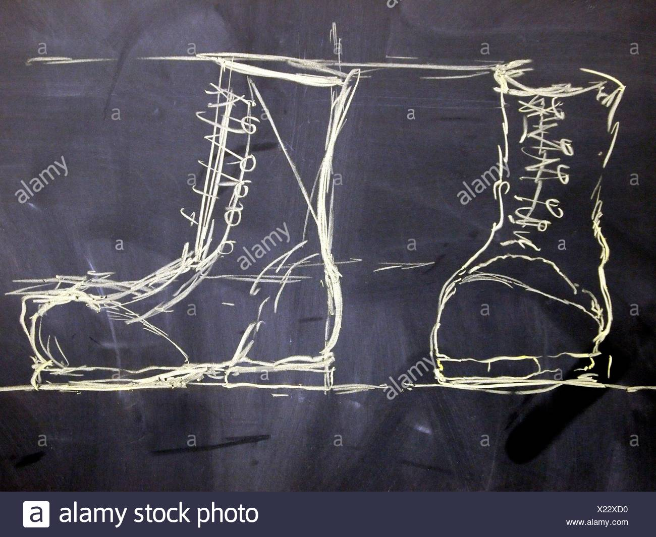 Chalk Drawing freehand two military boots Stock Photo