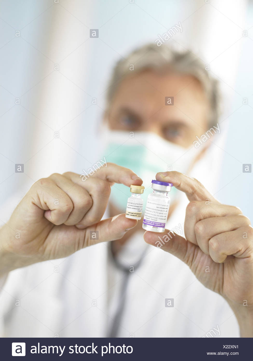 Doctor, mask, vaccines, point, - Stock Image