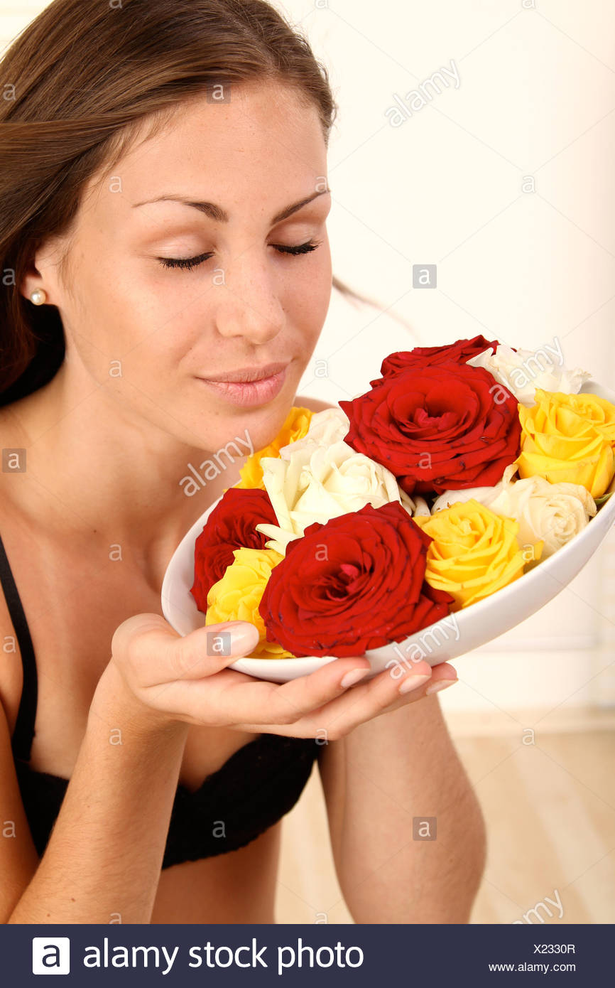 woman roses smell - Stock Image