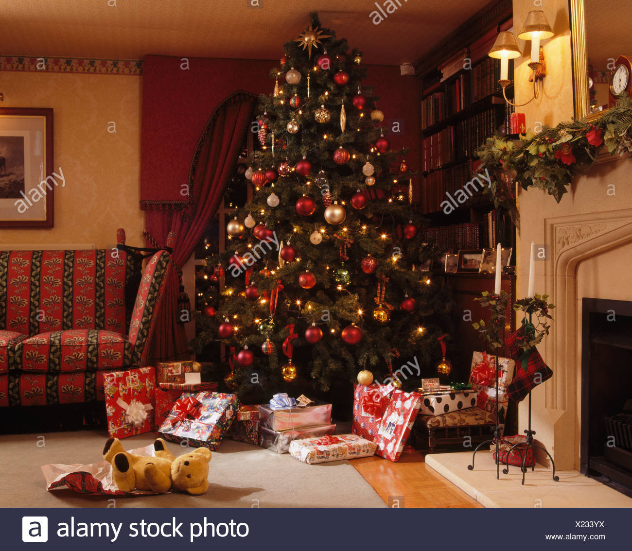 Interiors living rooms christmas trees stock photos interiors wrapped gifts below decorated christmas tree in traditional living room with lighted wall lighted above aloadofball Gallery