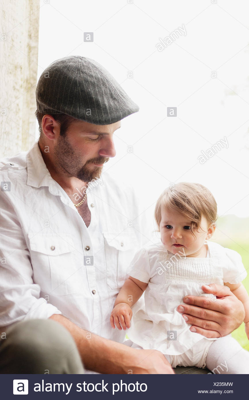Sweden, Varmland, Filipstad, Gasborn, Horrsjon, Portrait of man with baby girl (12-17 months) - Stock Image