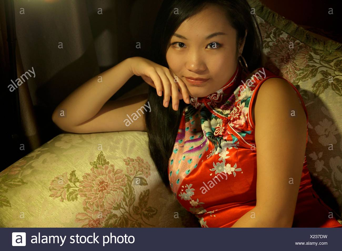 527b9aca9 Stock Photo. Enlarge. Portrait of a beautiful young Chinese girl wearing a  traditional Chinese dress qipao.