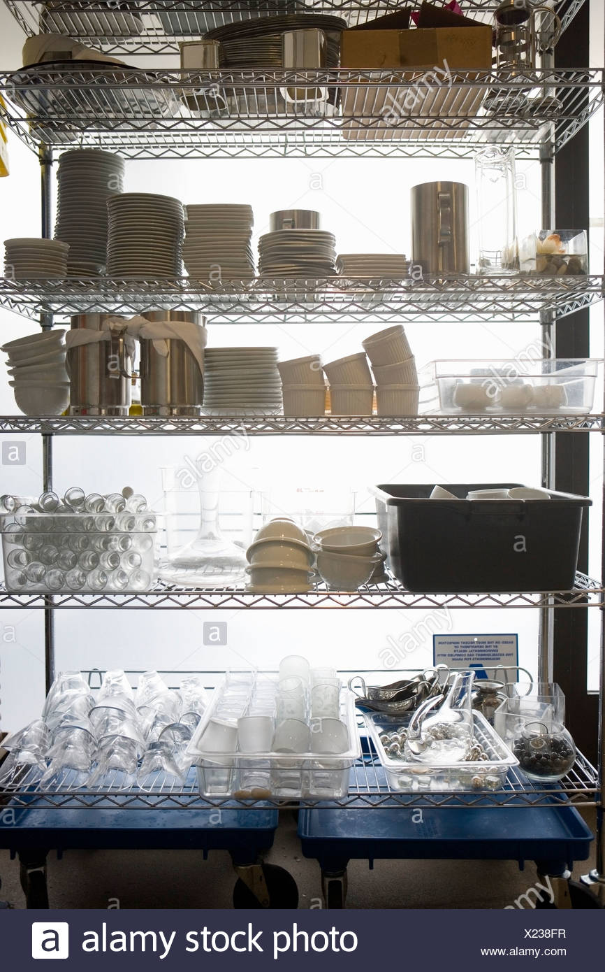 Dishes and containers on kitchen rack - Stock Image