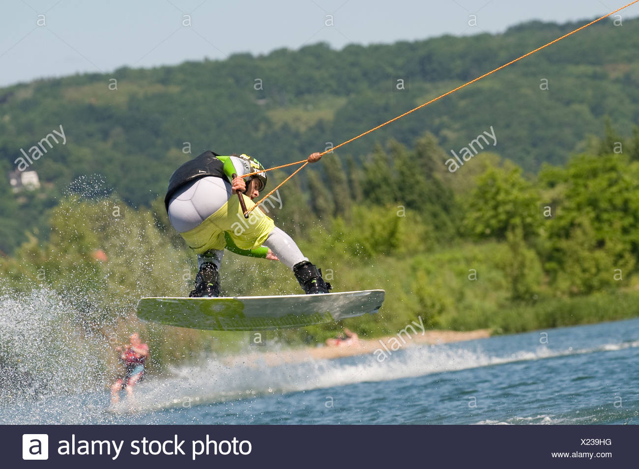 Dresden, Germany, man drives a wakeboard on a lake - Stock Image