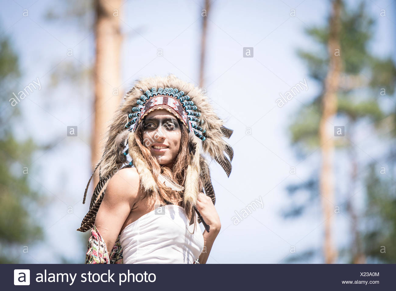Portrait of young woman masquerade as an Indian - Stock Image