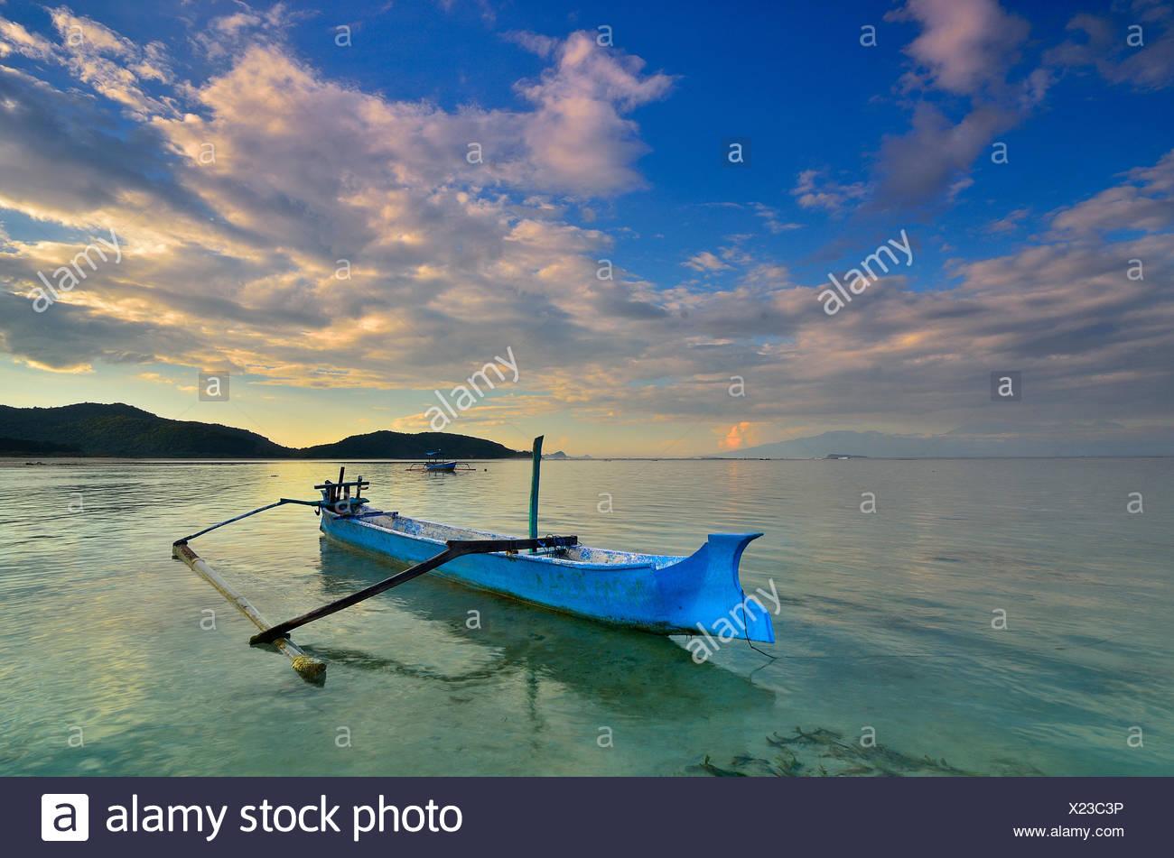 Boat anchored at Jelenga Beach, Sumbawa Island, Indonesia - Stock Image