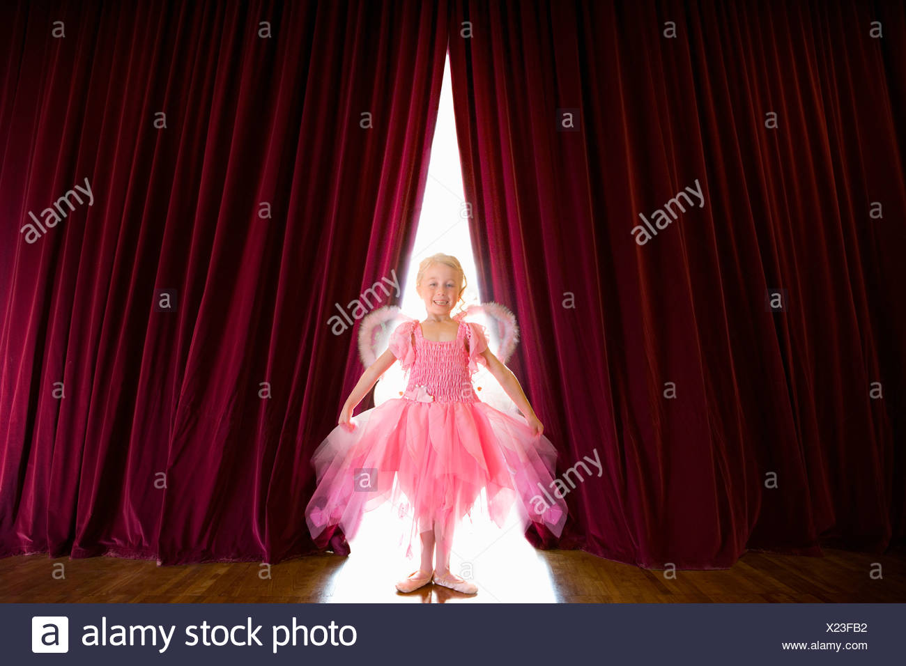 Ballerina posing on stage - Stock Image