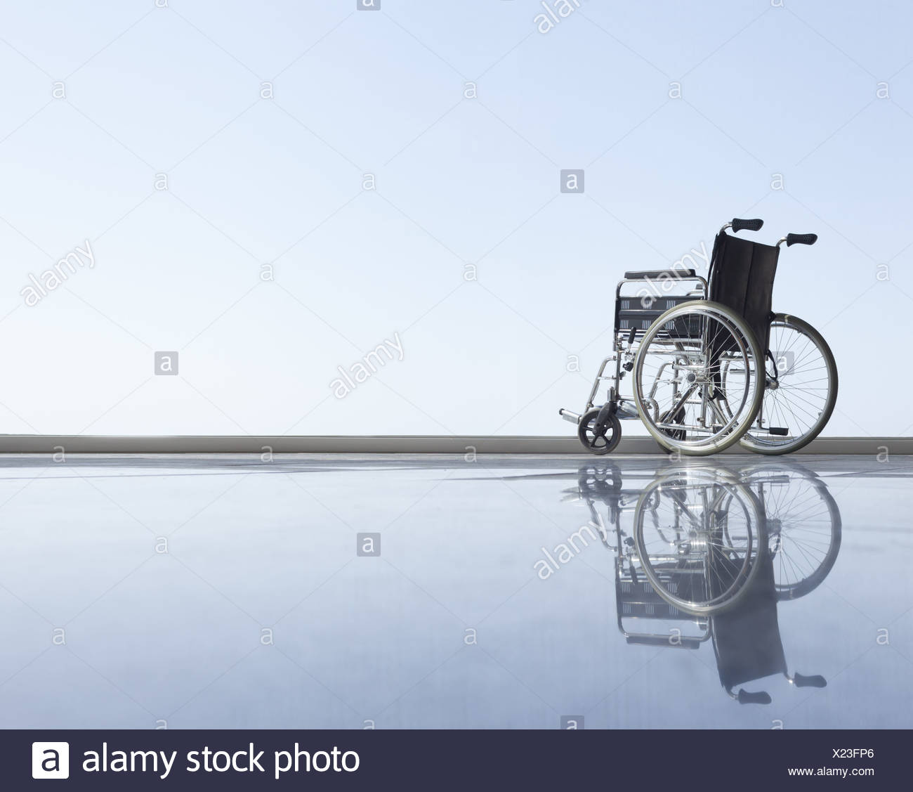 Wheel chair with horizon - Stock Image