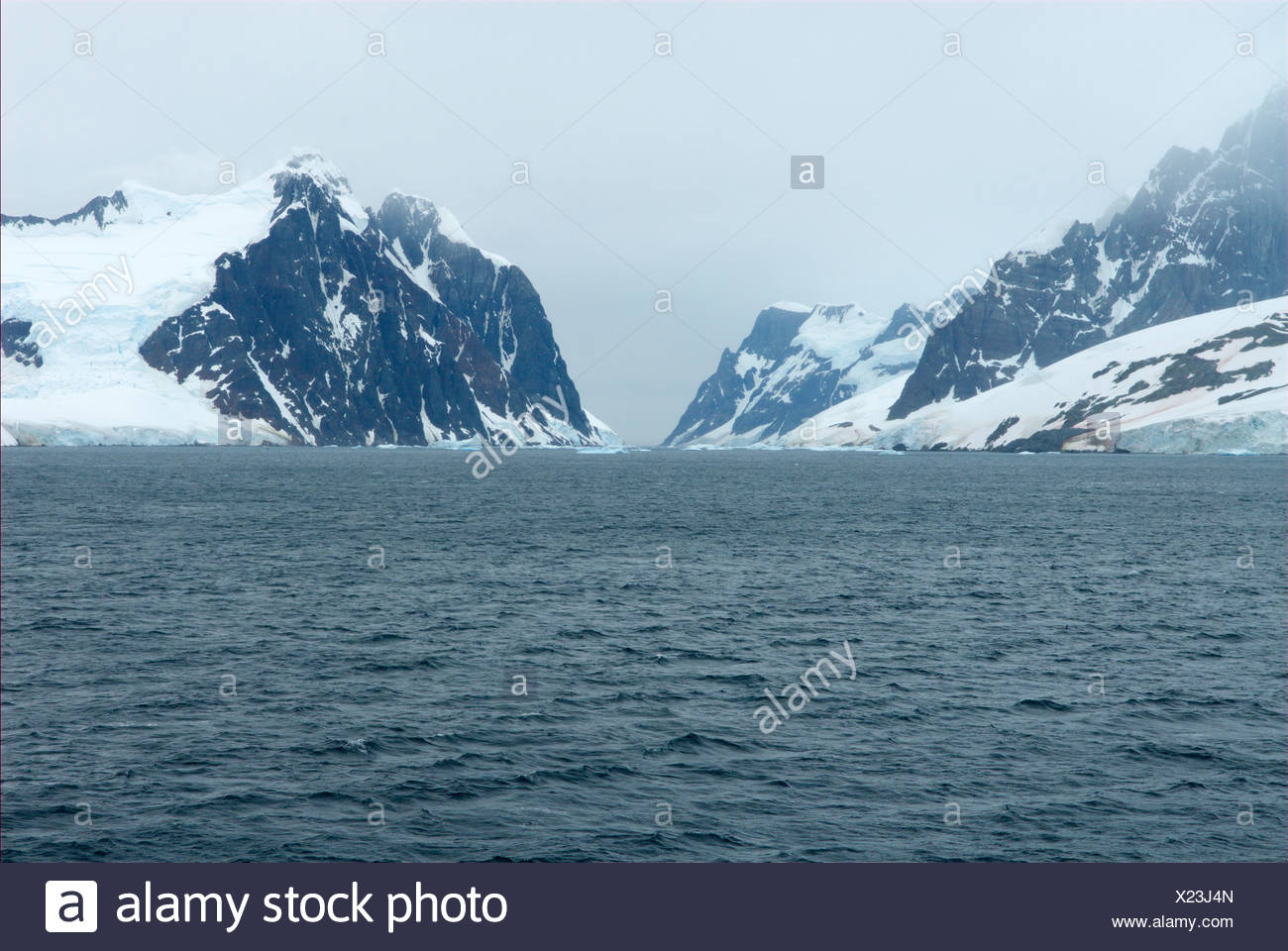 Iced mountains at the waterside - Stock Image