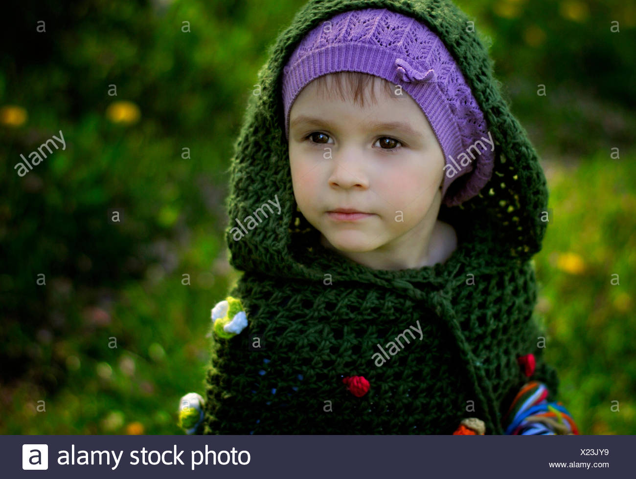 Young girl wearing green hooded top - Stock Image