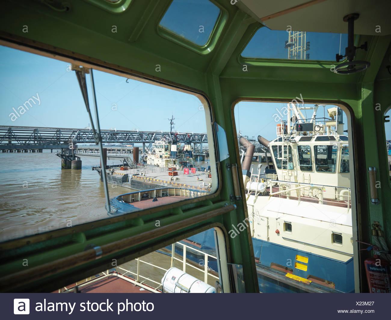 Tugboats in urban harbor - Stock Image