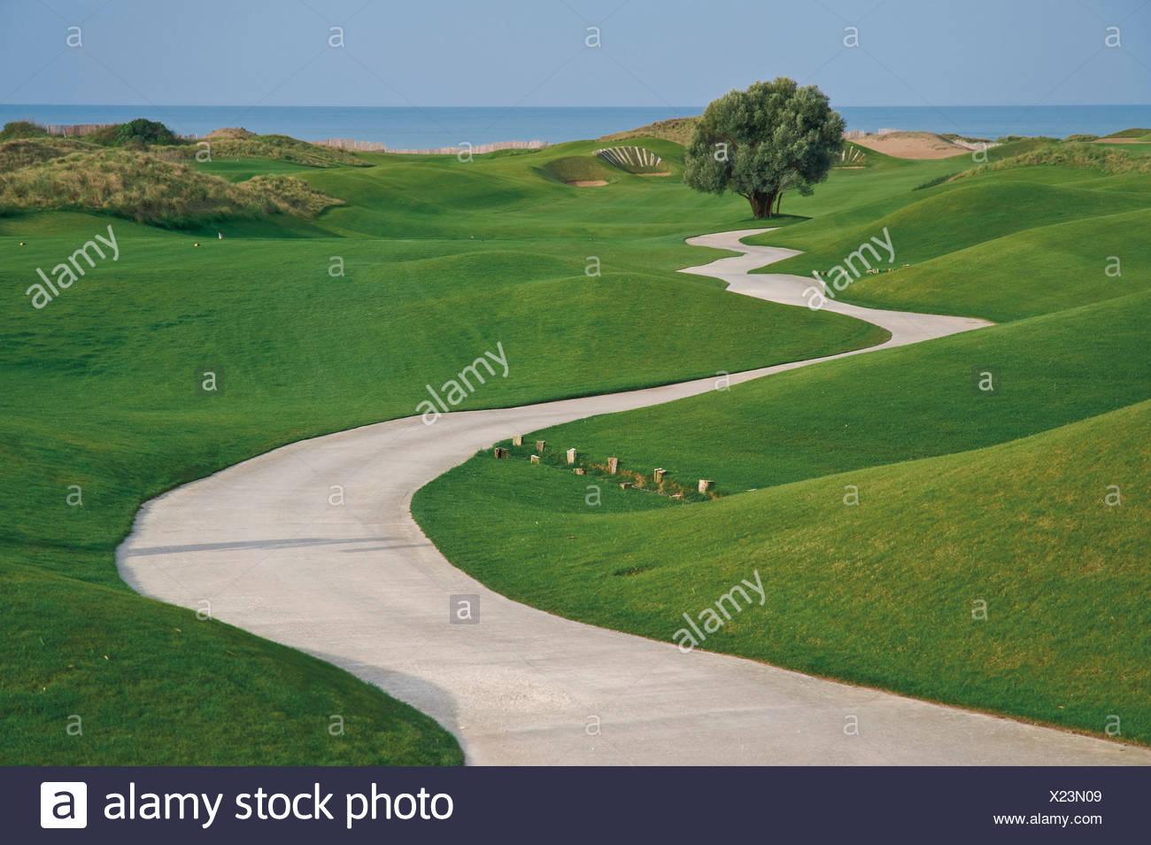 Turkey, Antalya, View of pathway passing through grass - Stock Image