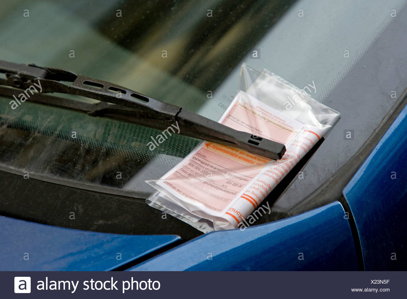 Parking ticket under the windscreen wiper of a parked car, Munich, Bavaria, Germany, Europe Stock Photo