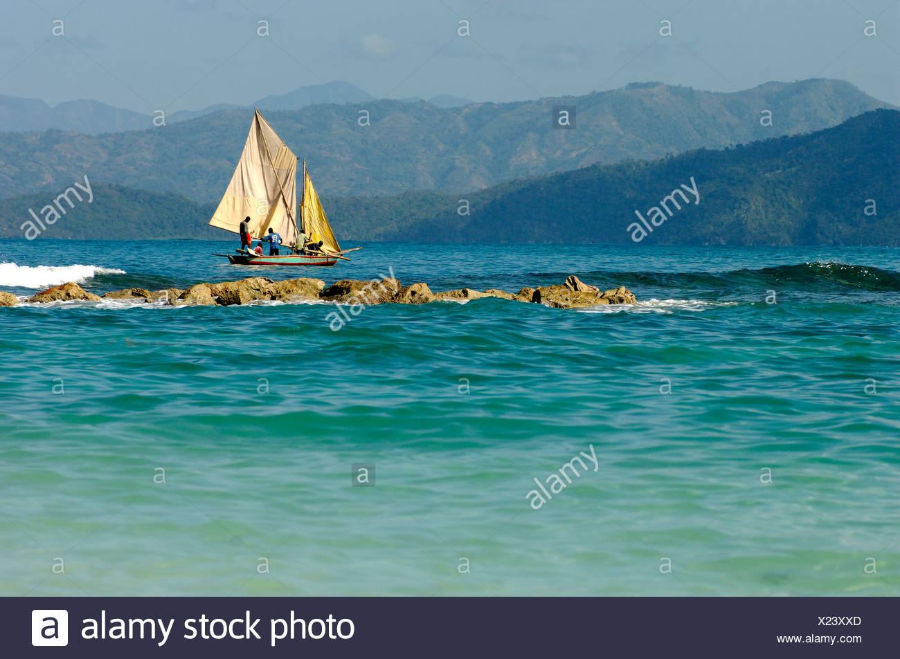 Haiti Labadee Caribbean Fishing Fisher Sailboat Boat Sea Ocean Coast - Stock Image